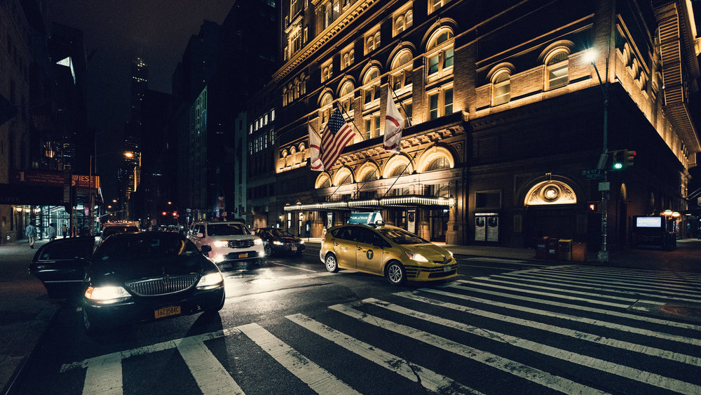 Sony A7Rii + Voigtlander SUPER WIDE-HELIAR 15mm F4.5 III - ISO 6400 1/125 - Carnegie Hall in the background. Using the 15mm to create one of my classic street scenes.