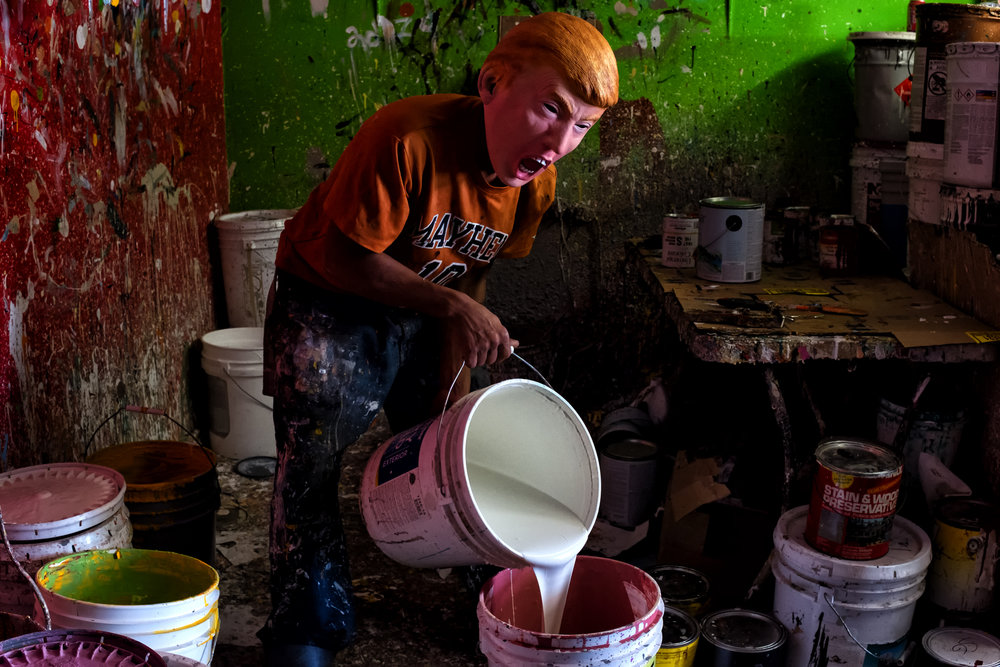 A trump mixing paints at a local business in Alamo, Texas