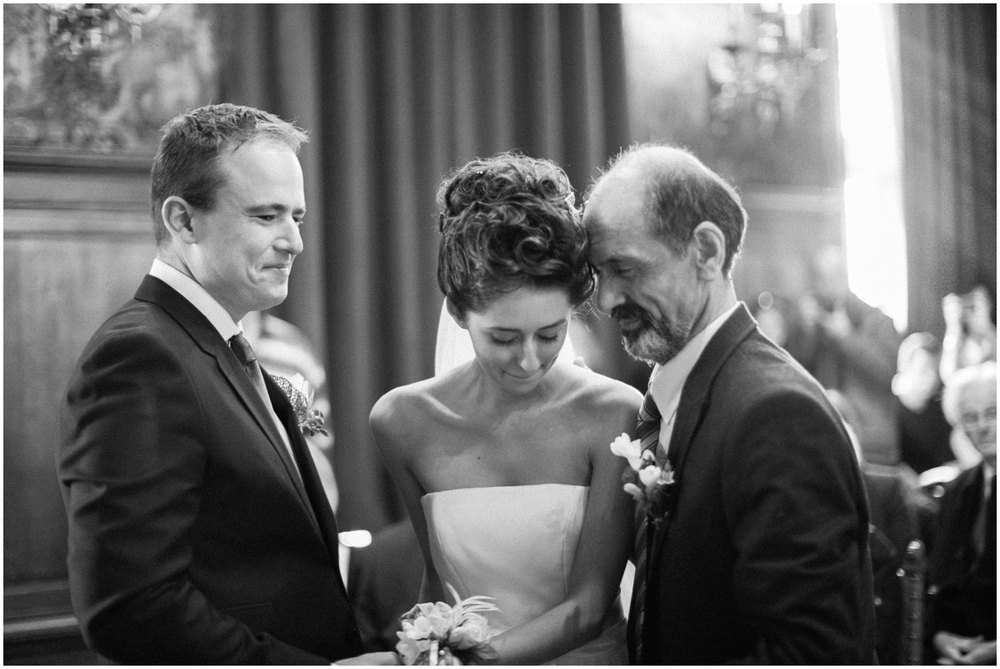 Father giving away his daughter at wedding