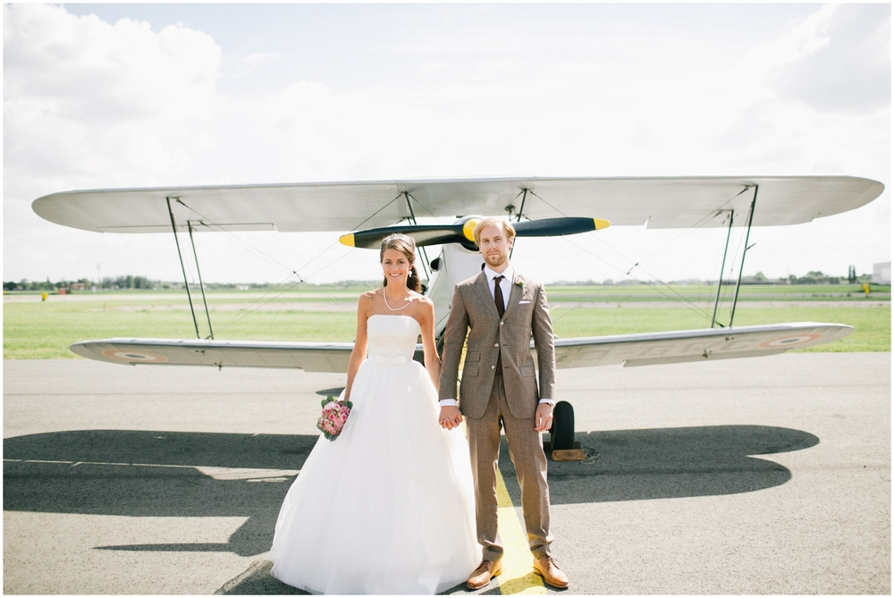 Bride and Groom in front of old plane