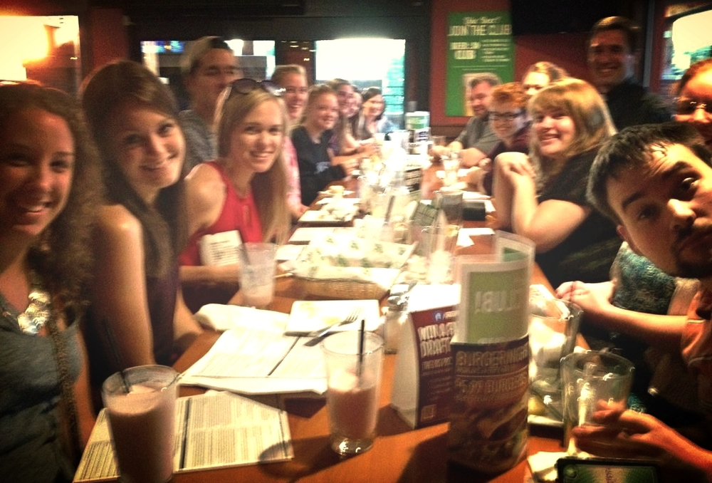"Fr. Craig Timmerman at Green Mill with young adults at ""Truth on Tap"" in New Ulm."