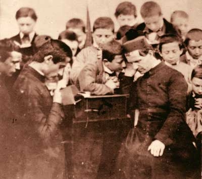 St. John Bosco with his spiritual children