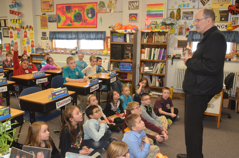 Bishop John M. LeVoir visits a classroom at Holy Redeemer Catholic School in Marshall. Annually, the bishop visits Catholic schools throughout the diocese.