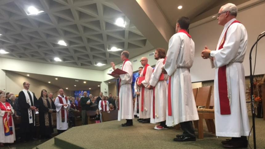 The Rev. Steve Verhelst, center, leads a service at the Church of St. Mary in Willmar Sunday to mark 500 years of Reformation. A number of pastors from area churches also participated in leading the service, which drew a crowd of more than 800 people from the area.  Photo by Rand Middleton