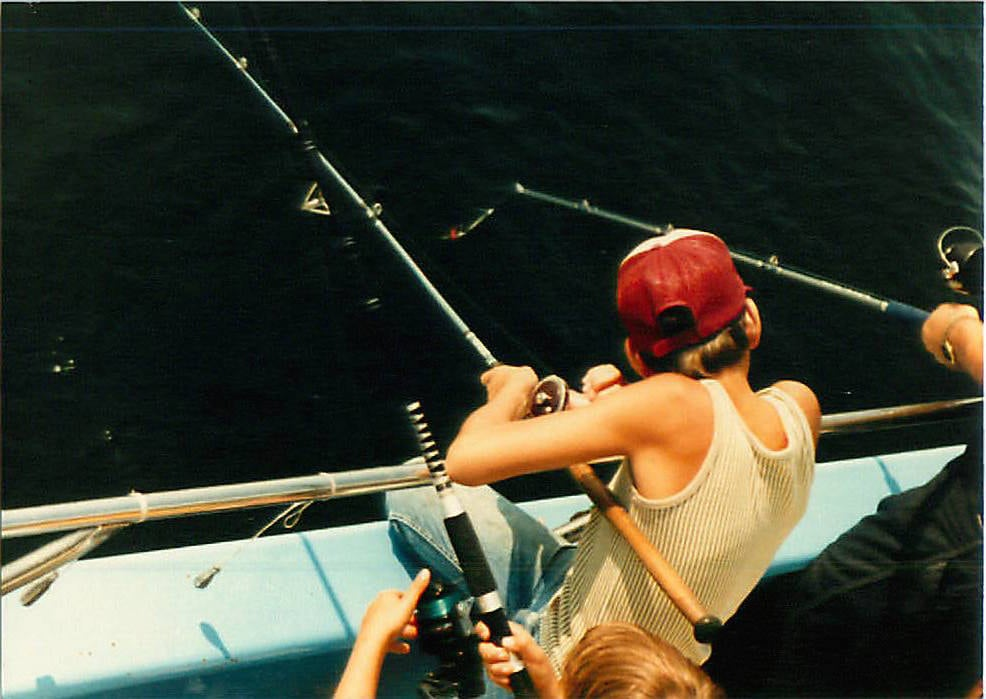 Me, Age 10 or so, reeling in something big.