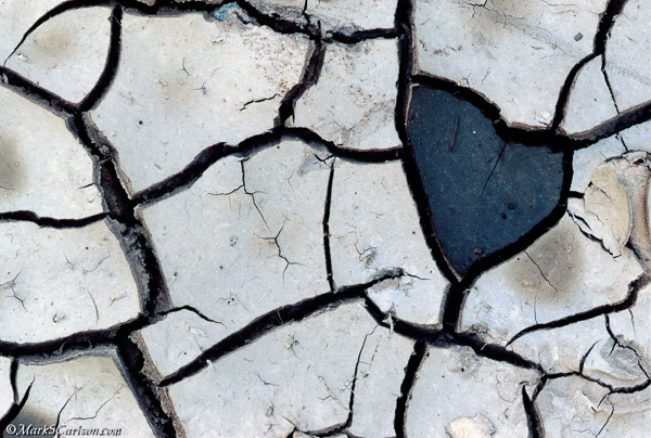 Dry, cracked mud with heart shape; ©markscarlson.com