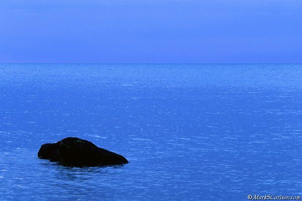 Rock, blue water, blue sky; ©markscarlson.com