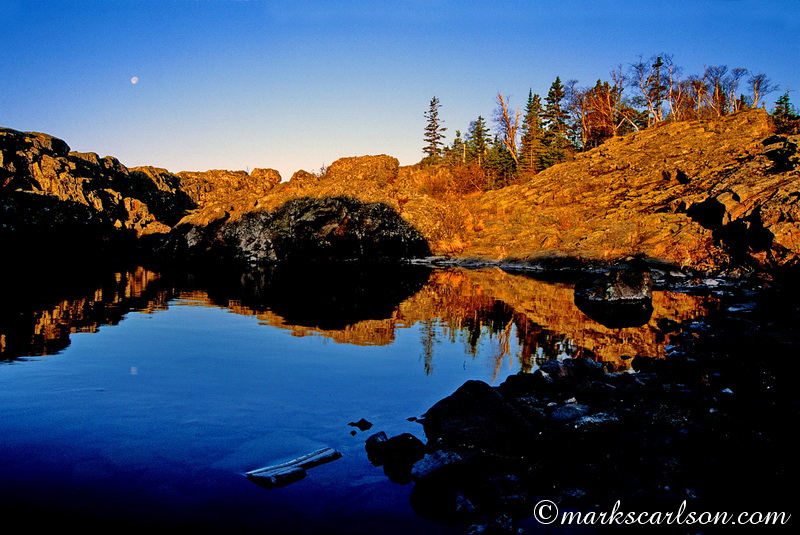 IRNP018-Moonset with rocky pool reflection at sunrise ©markscarlson.com