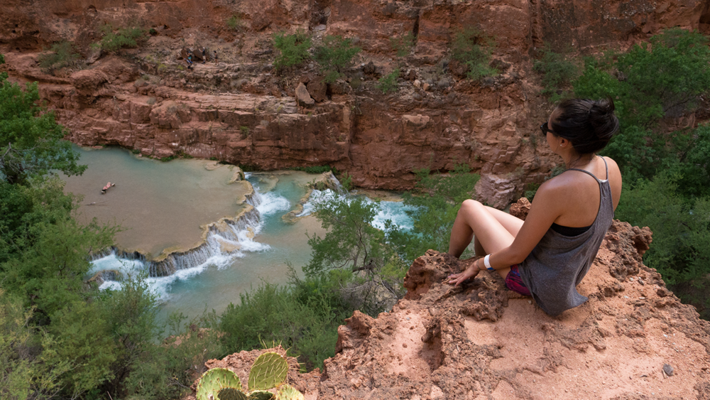 Diane Ly gazing down to Beaver Falls. One of the beautiful waterfalls in Havasupai Reservations.