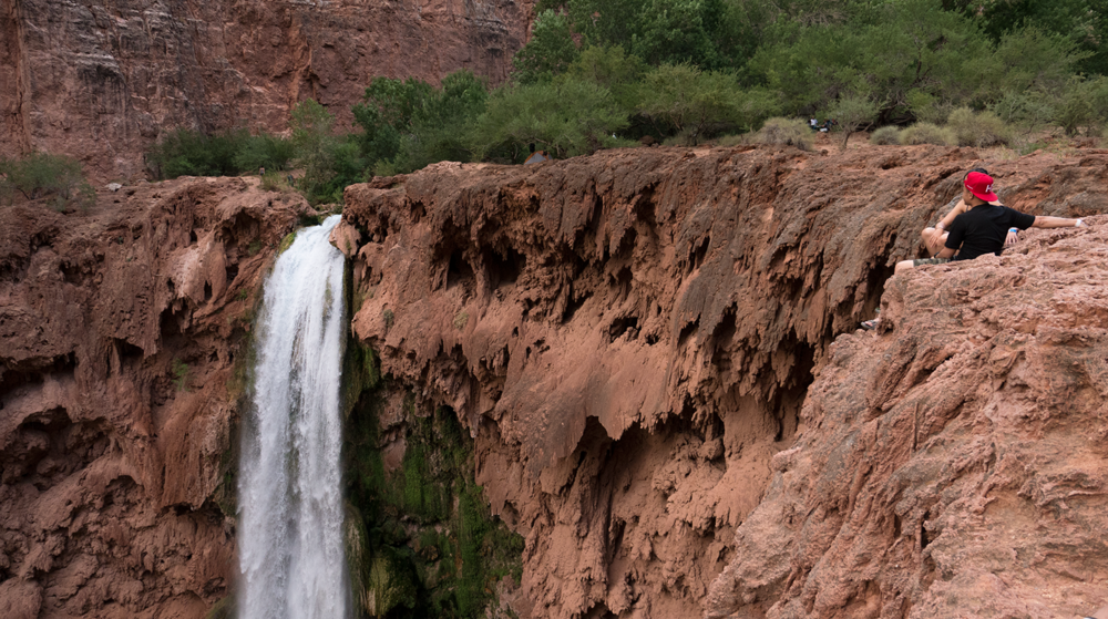 Chau Tran & Diane Ly observing the Mooney Falls in Havasupai Arizona. Copyright Hobo.Life