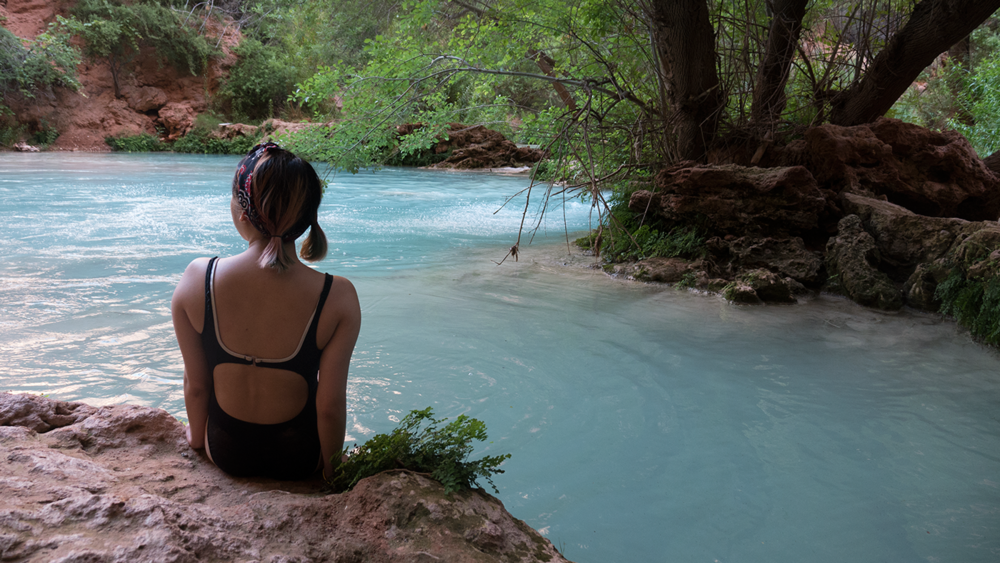 Anna Sohee Lee gazing into the distance at one of the swimming holes in Havasupai Arizona. Copyright Hobo.Life