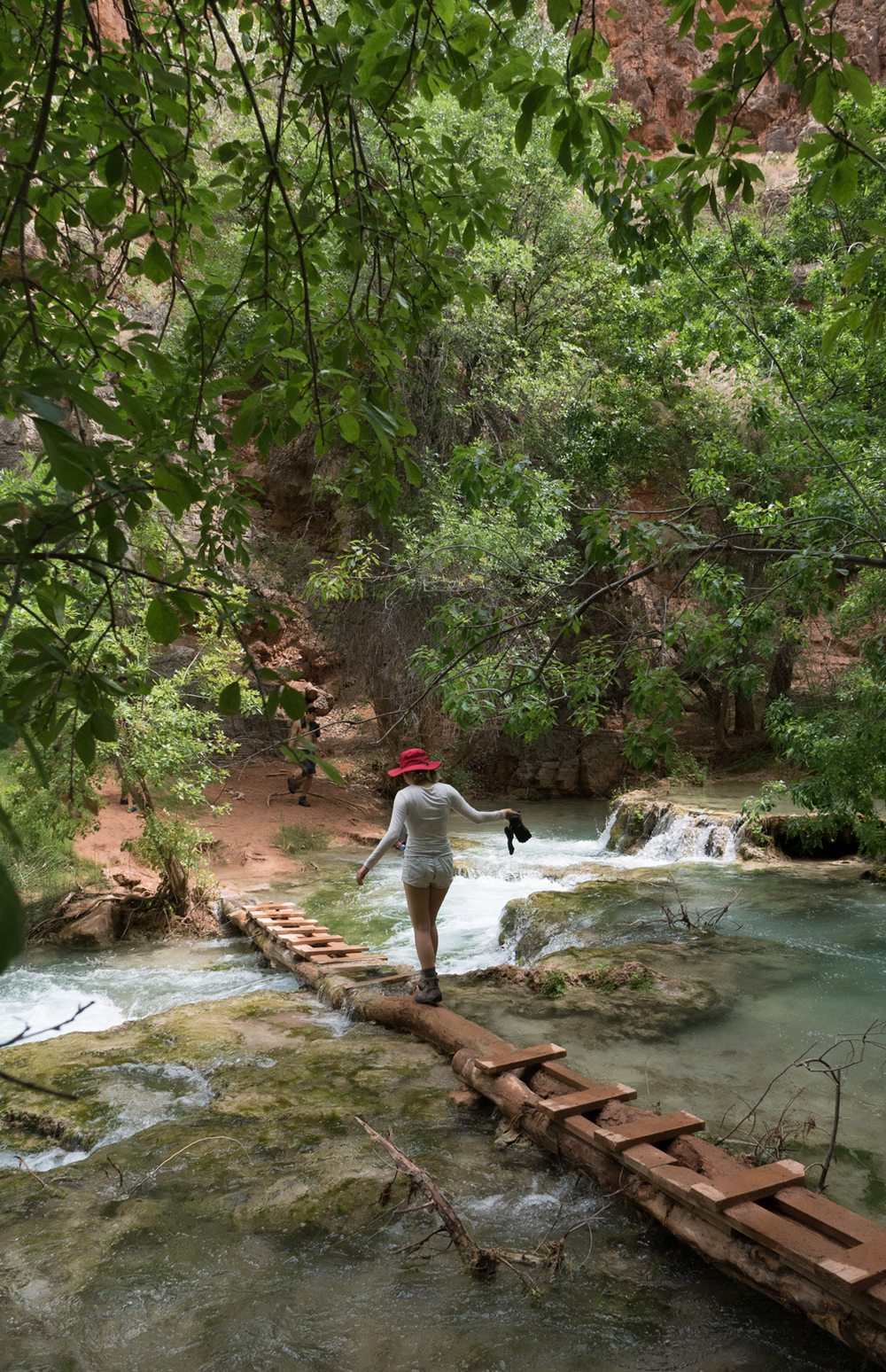 Anna Sohee Lee Crossing the river in Havasupai Falls Arizona