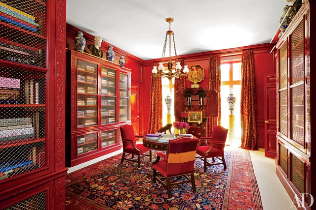 Red Lacquered walls make a bold statement in this design by Miles Redd.