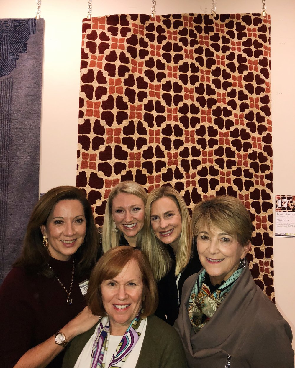 Our team having a blast at the Carpets for a Cause event at Oscar Isberian Rugs, in partnership with Designs4Dignity.  The rug we designed is featured behind us!