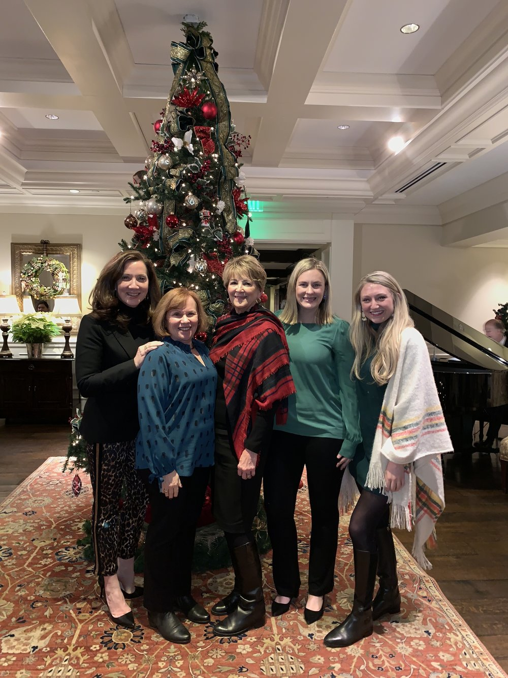 The Jeannie Balsam Interiors ROCKSTAR Design Team celebrating our best year at our annual Skokie Country Club holiday dinner.