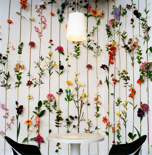 Real flowers are taped into the wallpaper.  Tensta Konsthall