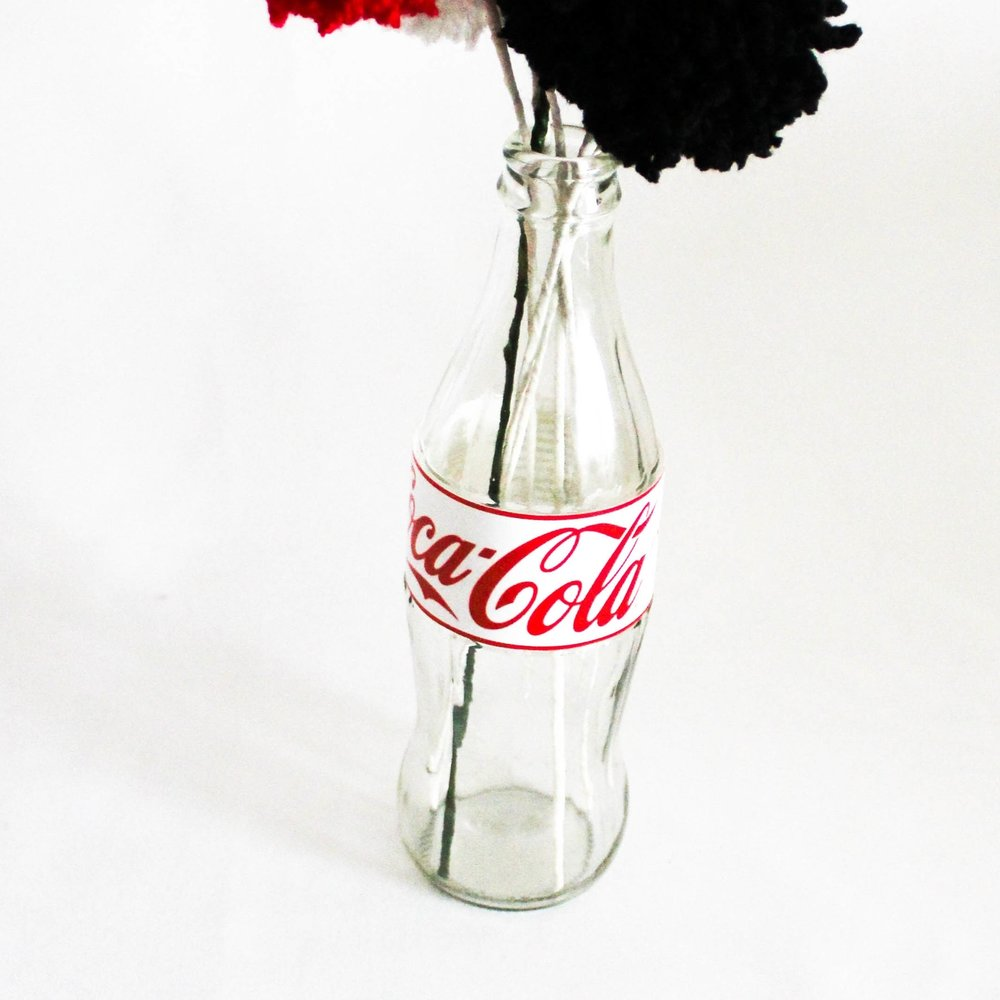 Classic Glass Cola Bottles - These coke bottles can be customised with any label you wish and can be a great holder of flowers (or pom poms) or any other flower you wish. Works great with an American or retro theme and the label can be customised to anything you wish.