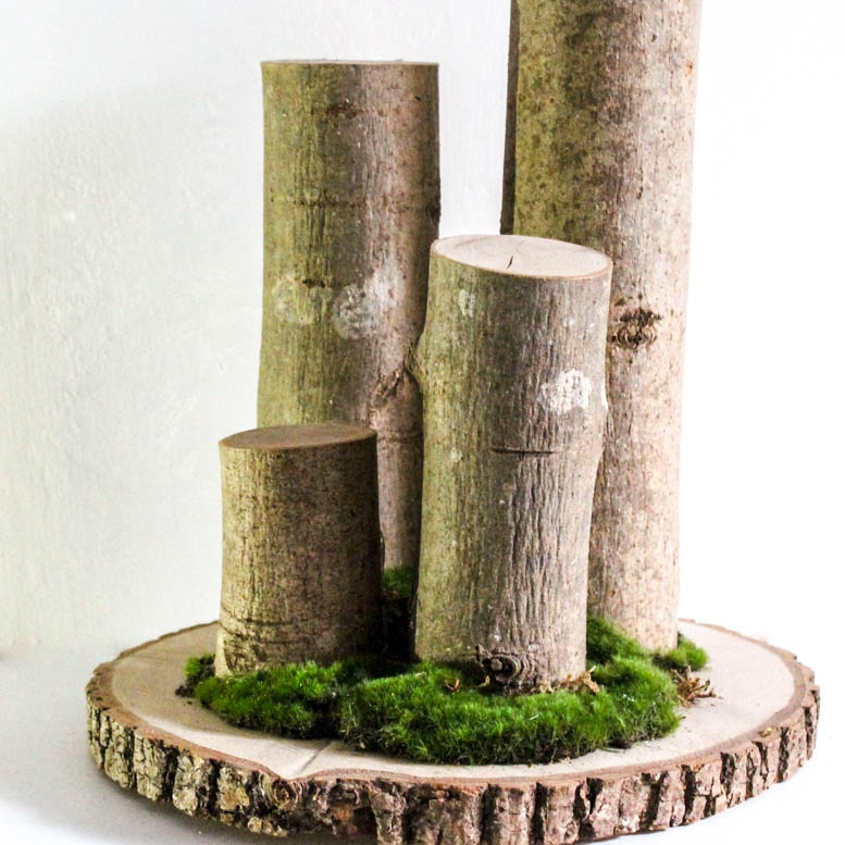 Log stands - These log stands finished with moss are a great way to add height to tables, window sills or anywhere else for that matter. You cankeep them plain or add bottles or jars or weave Ivy or flowers around them to addto the rustic texture of the autumnal style.