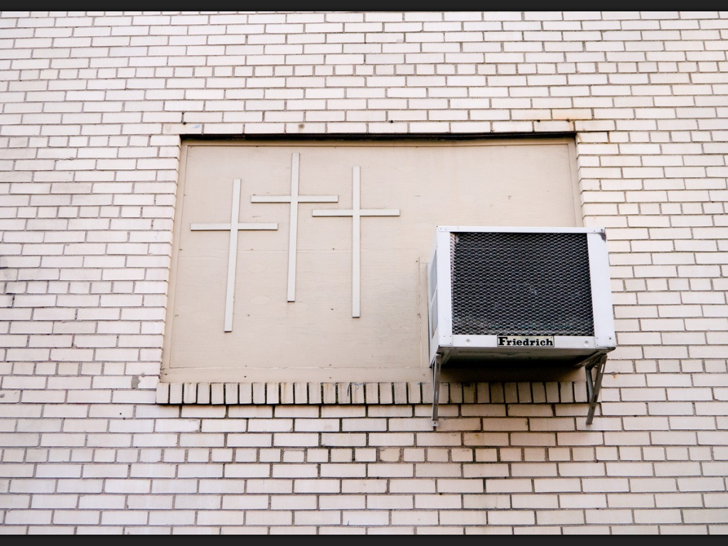 Three crosses and an air conditioner by Terry Richardson