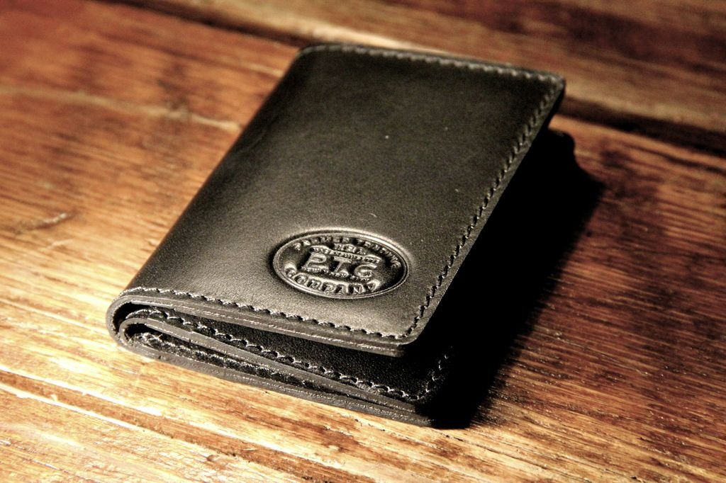 The PTC Subway Wallet      Triple fold. Made in Massachusetts of tough English bridal leather. We made it in saddle black or chocolate brown.
