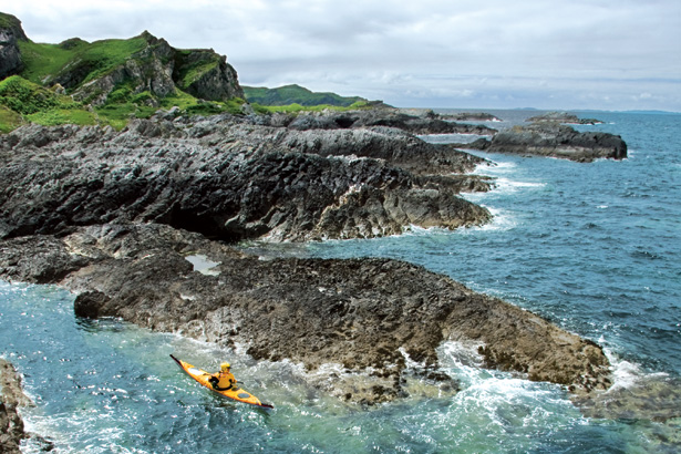 Todhunter paddling off the coast of Jura. Image by Gareth Brown, courtesy of National Geographic Adventure.