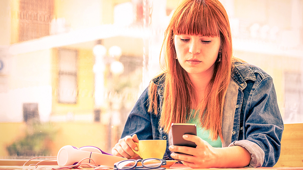 young woman reading phone cropped.jpg