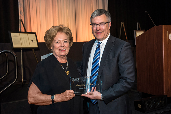 Dr. Andy Keller (right) presents the Texas Impact Award to Sharon Butterworth.