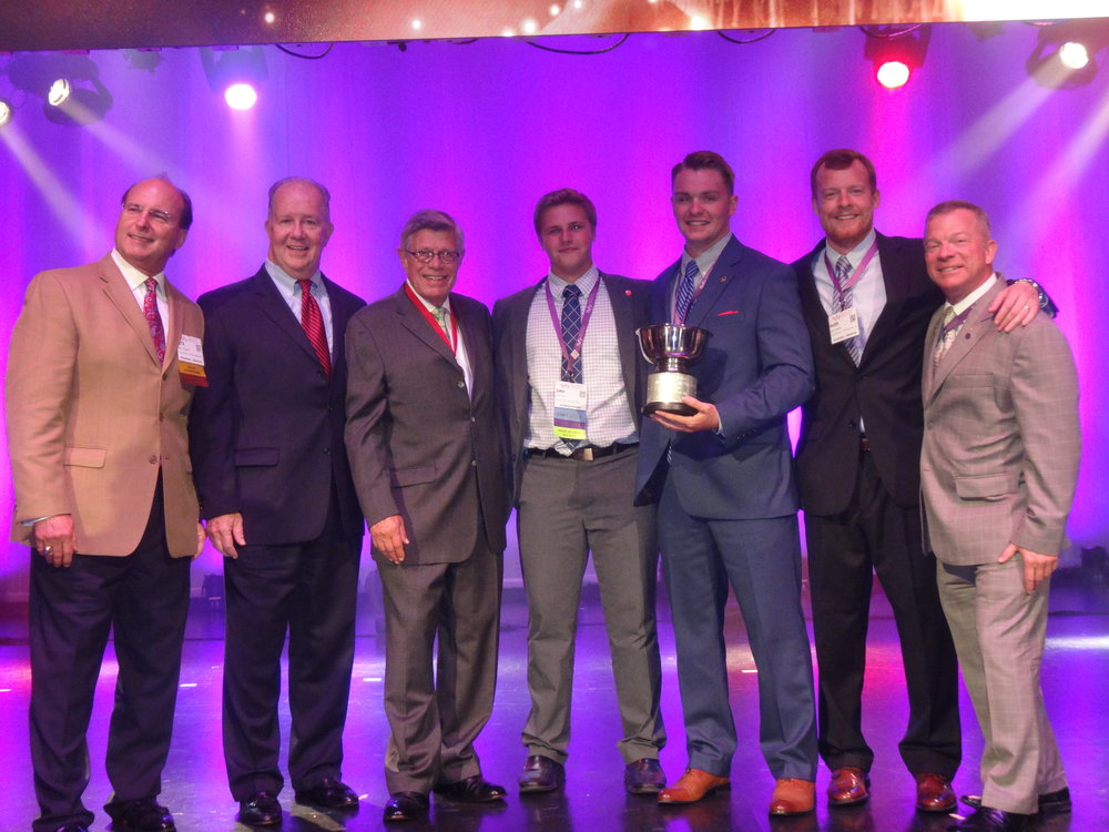 (Left-to-Right: Brothers Denny Fitz, Mike Duggan, John Hartman, Jacob West '20, Jackson Giebler '18, Keith Boatright, and John Hopson receiving SigEp's coveted Buchanan Cup Award at the 55th Grand Chapter Conclave in Orlando, Florida!