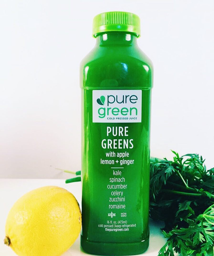 pure green cold pressed juice with apple lemon and ginger