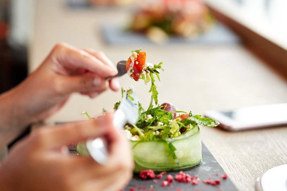 woman eating clean salad
