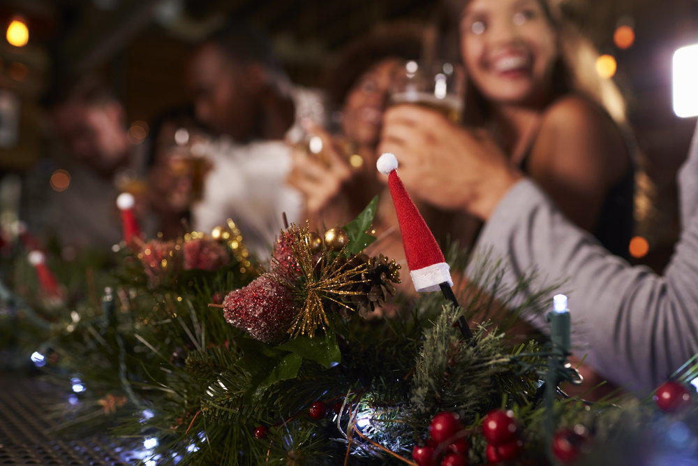 christmas-party-at-a-bar-focus-on-foreground-PLDAF4C.jpg