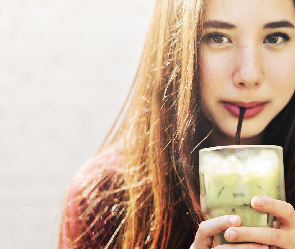 woman-refreshing-herself-with-green-tea-PB92654.jpg