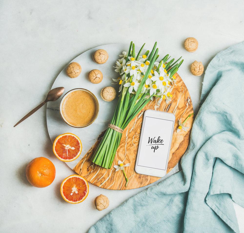 coffee-cookies-oranges-flowers-mobile-phone-with-PRMAE3N.jpg