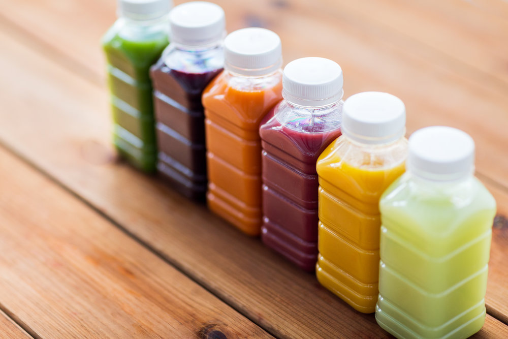 bottles-with-different-fruit-or-vegetable-juices-PUN8S4H.jpg