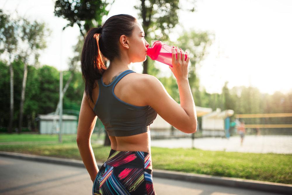 woman-drink-water-from-sport-bottle-PF5TXN6.jpg