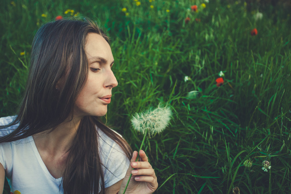 allergy-free-concept-woman-blowing-dandelion-FK2A8Q5.jpg