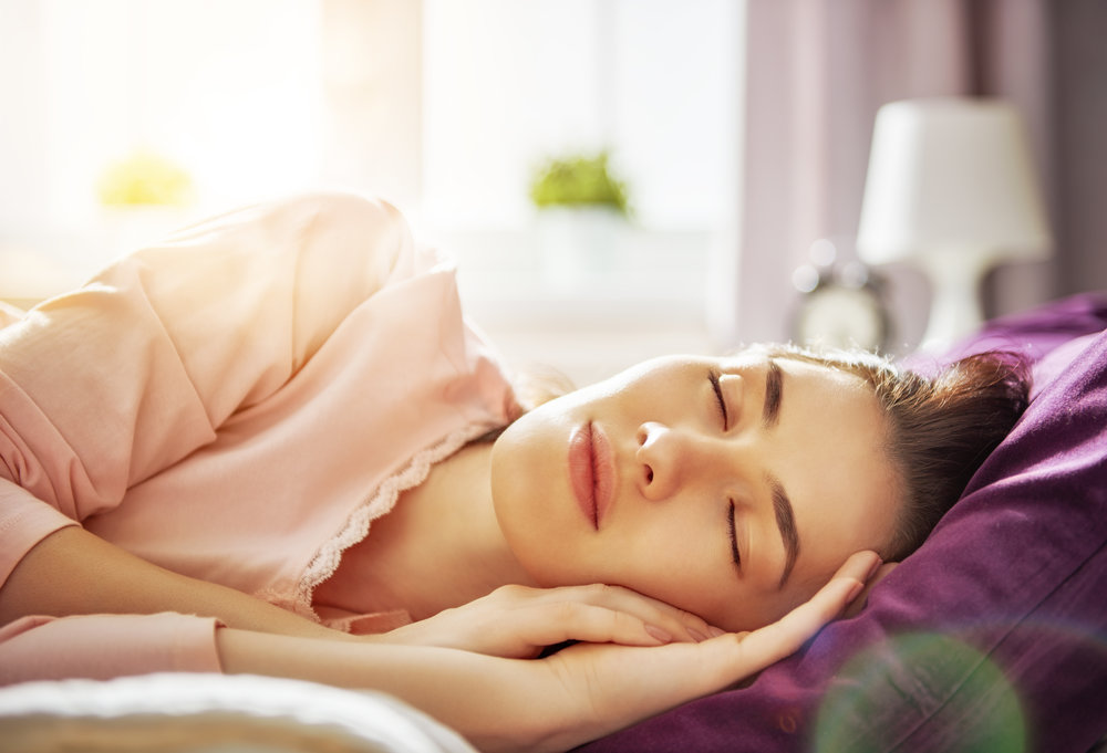 woman-sleeping-sunny-morning-PFYF7CG.jpg