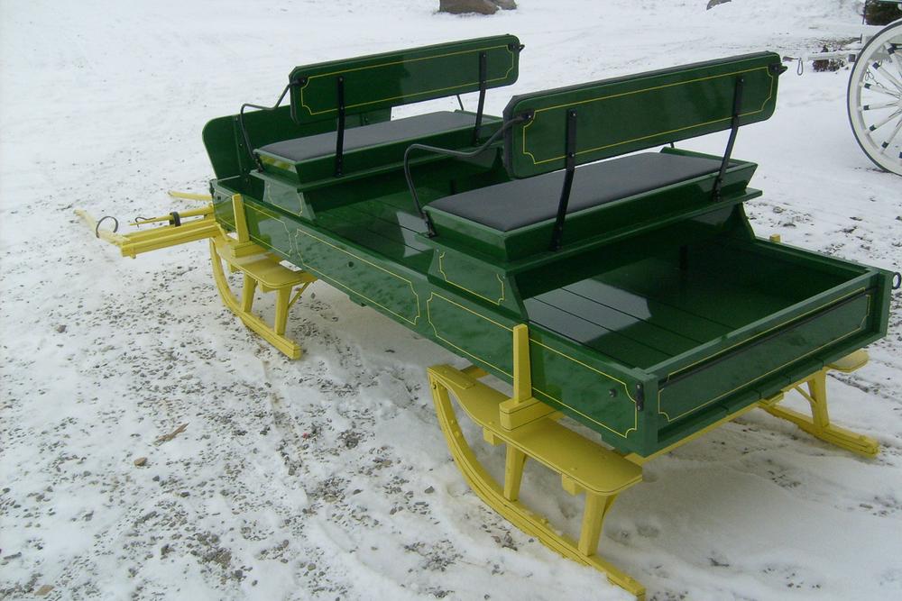 green-sleigh-6300510.jpg