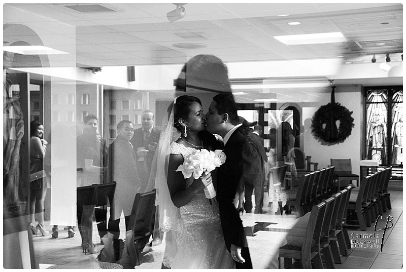 This image is one of my favorites that I've ever captured. Love that I caught them in a quiet moment waiting to sign their marriage certificate. You can see their friends and family in the reflection trying to figure out where they are.