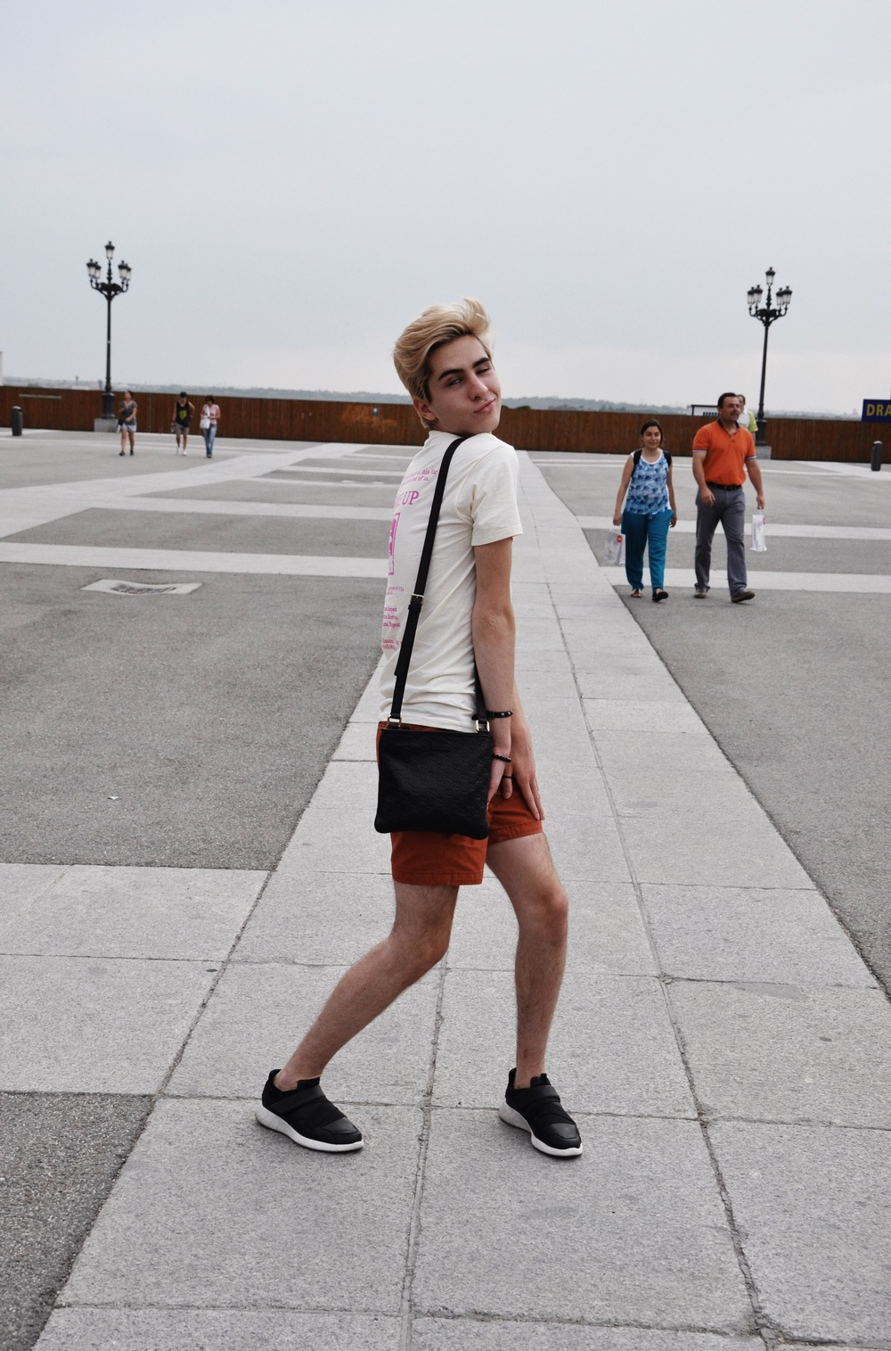 Silliness outside the Palace.  Sneakers : Zara &  Messenger   Bag : Gucci