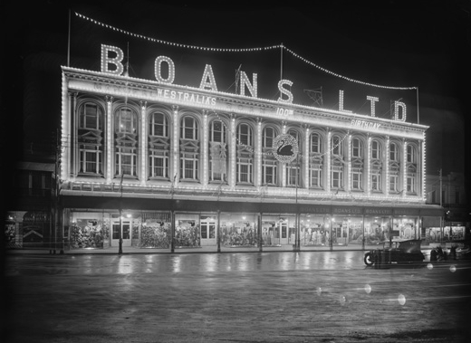 Boans building illuminated at night for the celebrations. (Supplied: State Library of Western Australia)
