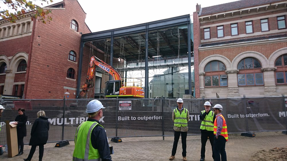 Western Australian Museum on 22 May 2017 as the glass insertion between Hackett Hall and the Jubilee Building is removed as part of the ongoing New Museum for Western Australia project. The Old Perth Gaol building is visible through the site in the background. The Western Australian Museum closed in 2016 during the course of the development and will reopen in 2020. (Supplied: Community News Group)