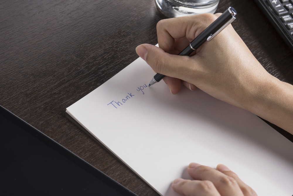Woman Writing Thank You