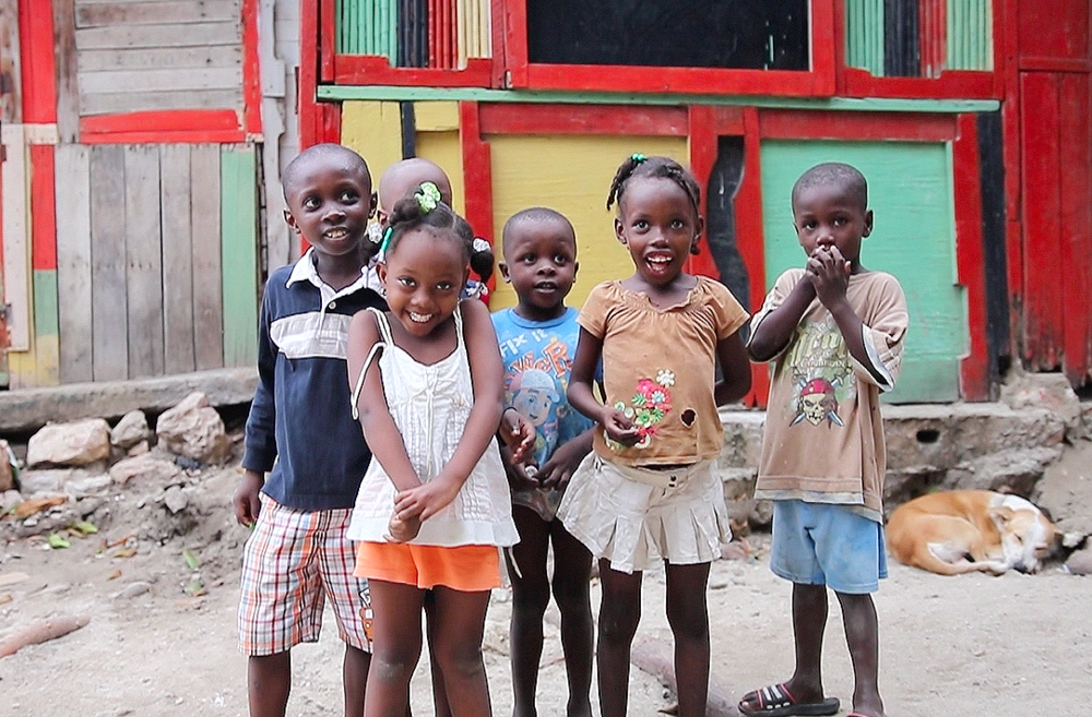 THE SMILING FACES OF THE CHILDREN WHO LIVE IN LABADEE VILLAGE IN NORTHERN HAITI.