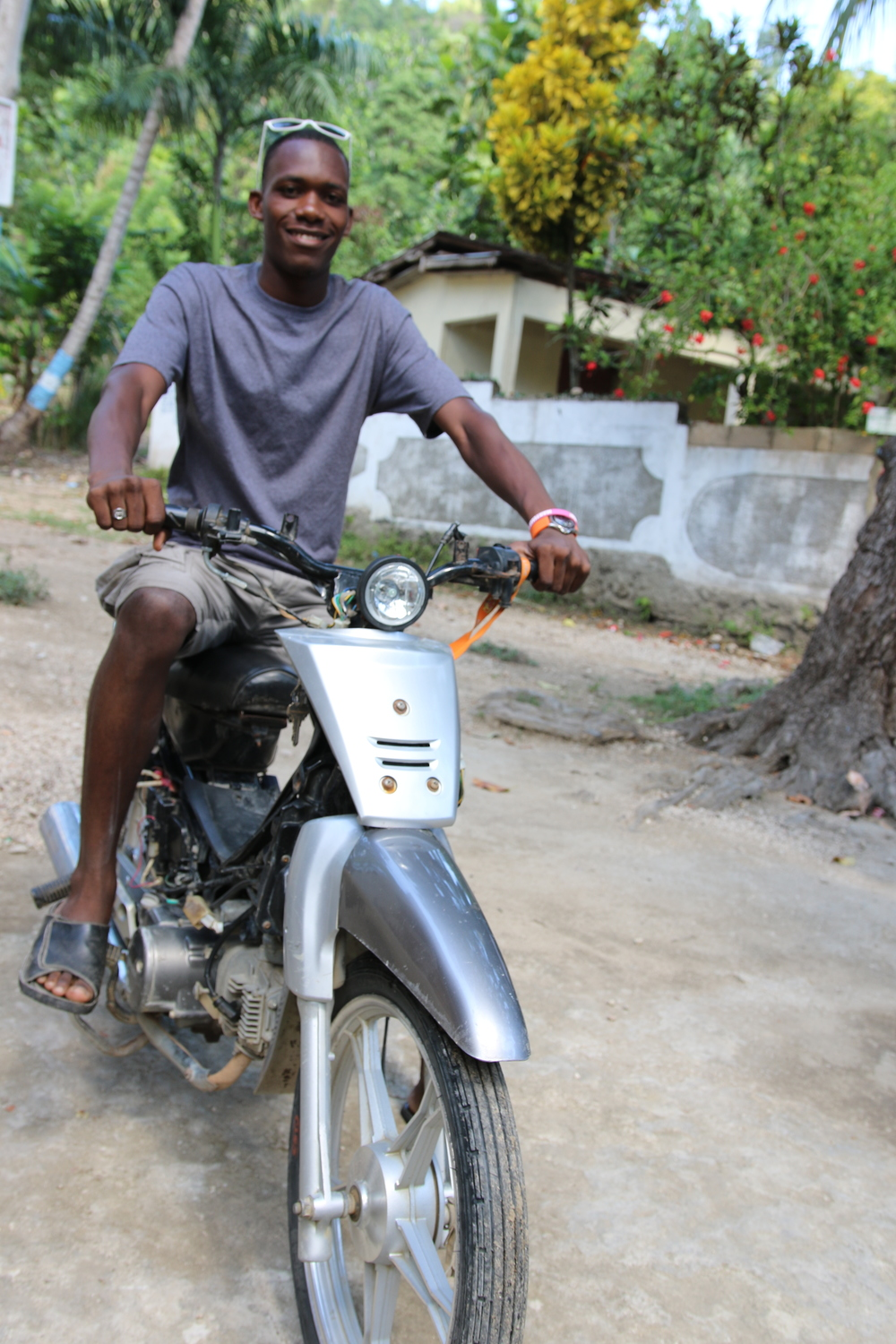 Haitian on a motorbike in Bassin Bleu