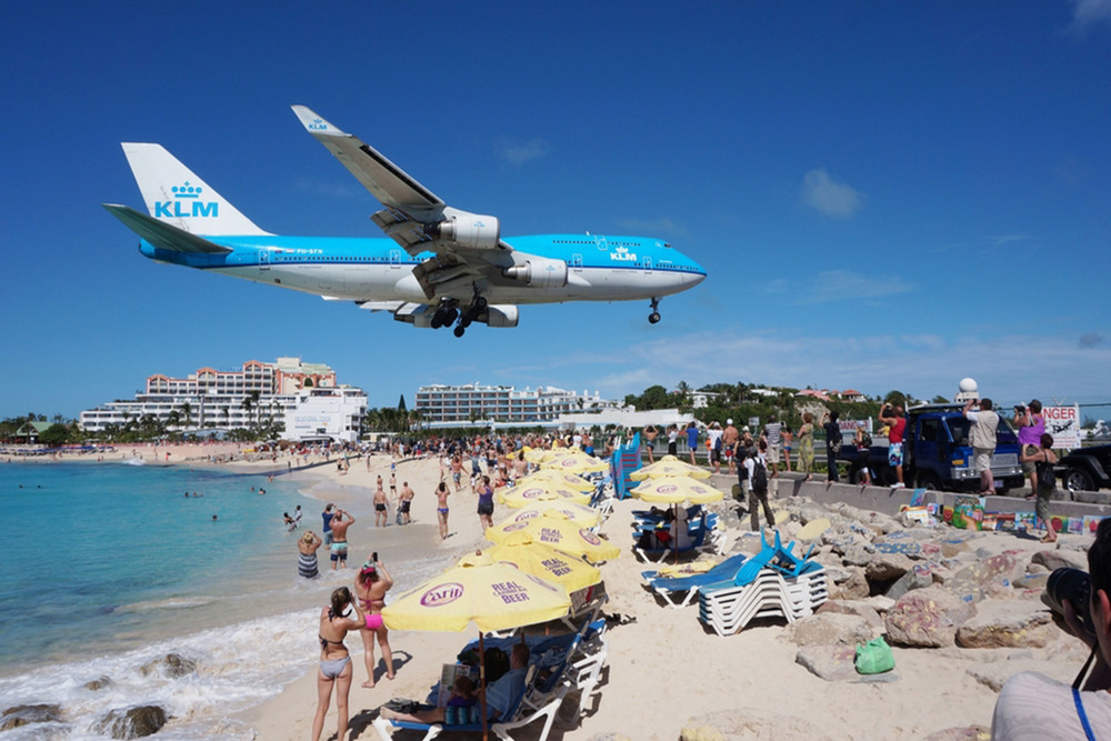 Plane flying over Maho Beach