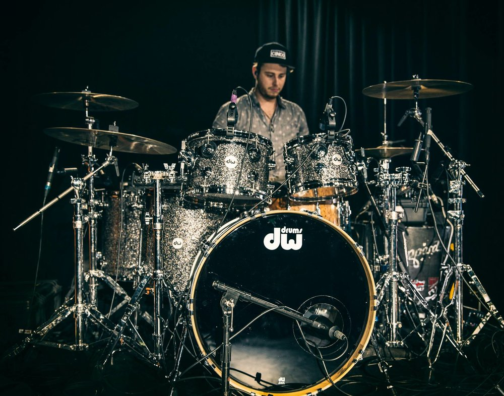 Meet Dean, our resident drum teacher at Audrey's. Dean Gordon began playing drums at the age of 12 and since 2013, has been playing for ARIA award winning Brisbane band, Sheppard. He has performed around the world in front of hundreds of thousands of people at music festivals such as Rock In Rio, Lollapalooza, Austin City Limits and Pinkpop.  Dean's experience in live performance and studio work has granted him with an insight that he is able to pass down to newcomers and also existing players in a fun and enthusiastic way.  He is excited to be joining the team at Audrey's Music.