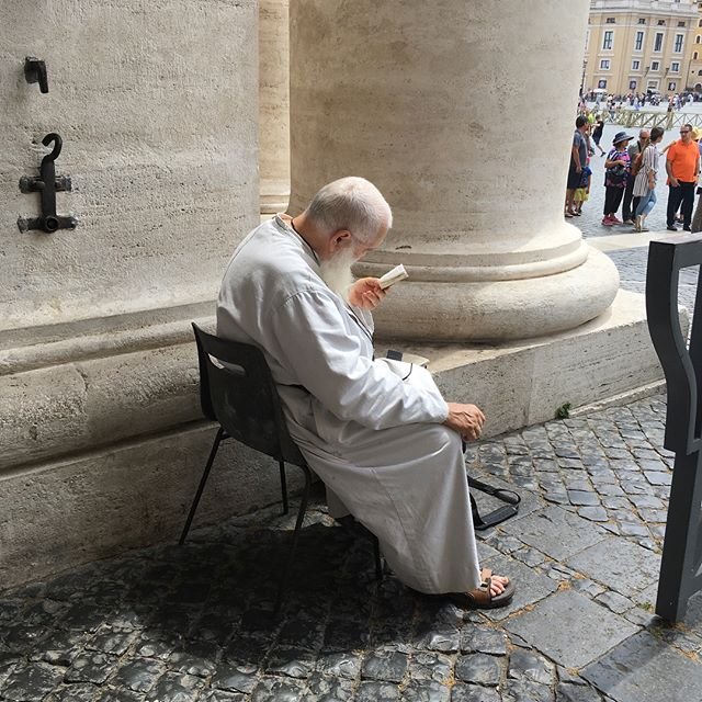 as i departed the crush of humanity that were today's visitors to the vatican, i happened upon this focused soul reading his tiny paper liturgy. i sat near him for a short bit, gathering peace from his directed stillness. (who do you need to be near to help you remember what it's all really about?) . . . #vatican  #vaticancity  #focus  #calming  #monastic  #monk  #bestill  #betheone  #sacredartofliving