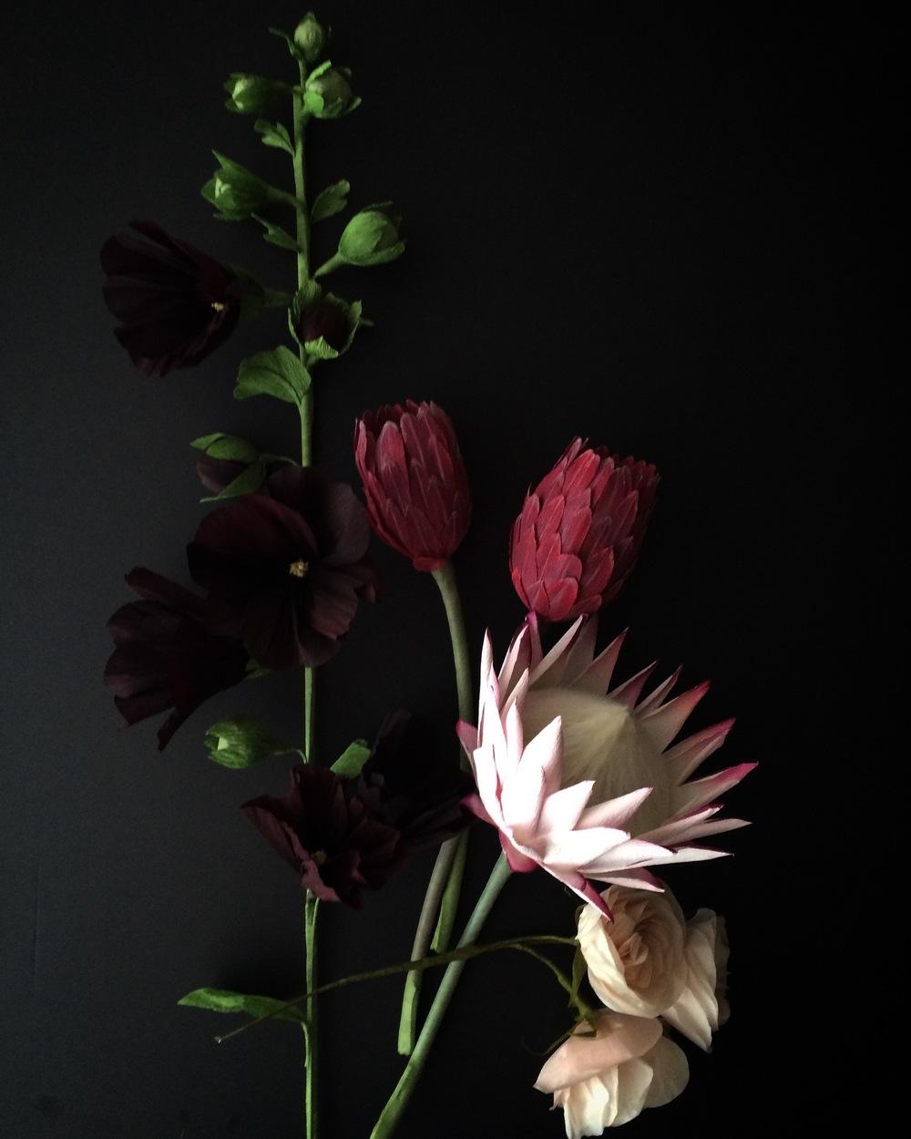 proteas, hollyhocks, garden roses