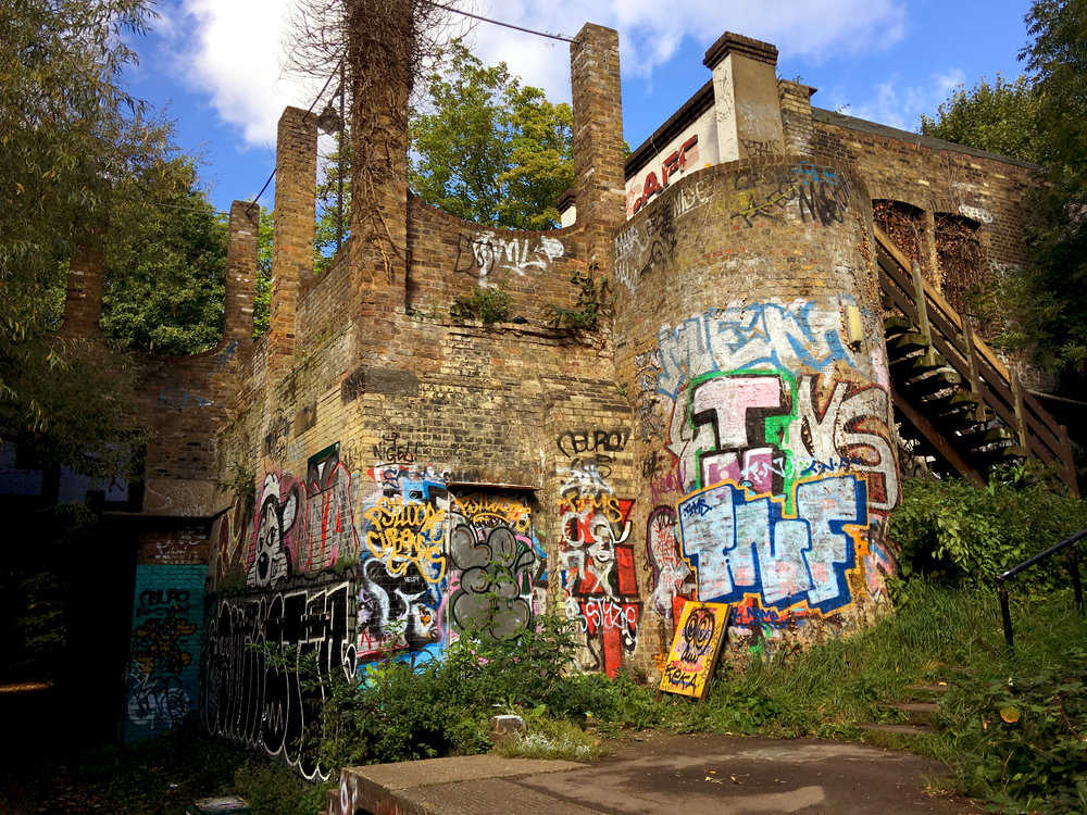 The abandoned Crouch End Station on the Parkland Walk, now covered with vibrant graffiti.